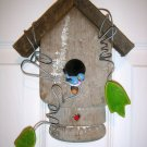 Handcrafted birdhouse from old porch post