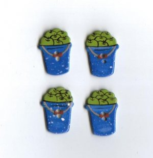 Handcrafted decorative ceramic buttons Green apples in Bucket