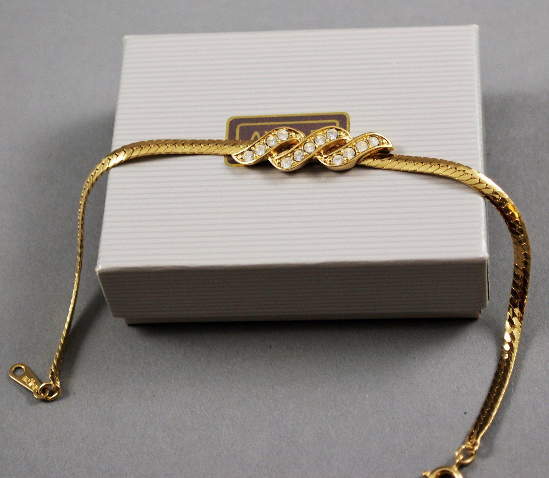 Avon 1986 Sparkle Twist Bracelet Clear Rhinestones Gold Tone Setting