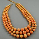 Triple Strand Orange w/ White Swirls Graduated Bead Vintage Necklace