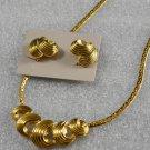 Avon 1989 Jewelry Ribbon Curl Goldtone Necklace & Clip Earrings