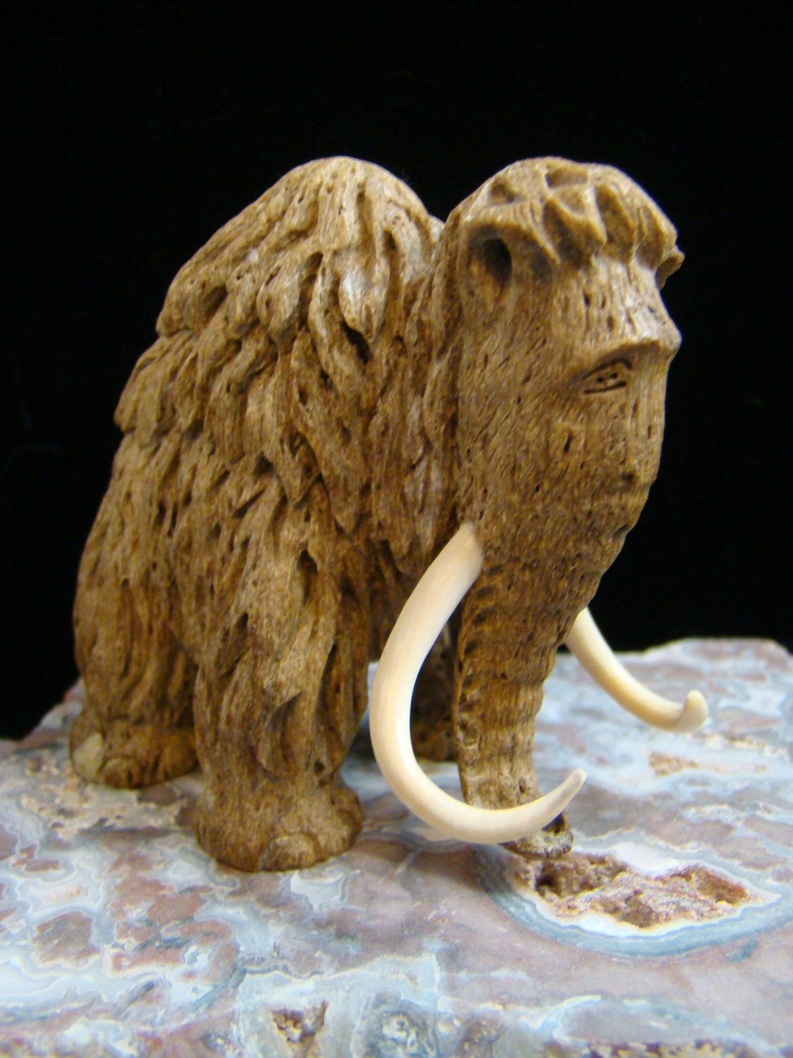Baby mammoth inuit eskimo carving fossil ivory tusk